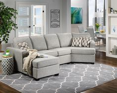 Comfort Center. The Downtown sectional sofa draws family and friends to your living room with its style and comfort. With a stretch out-worthy chaise on one side and the curl up-friendly curved cushion on the other, this sectional sofa promises relaxation all around. Three multi-hued geometric toss pillows offer modern accents. Made in Canada. Two-piece sectional includes left-facing chaise with sofa and right-facing curved chair, as shown.