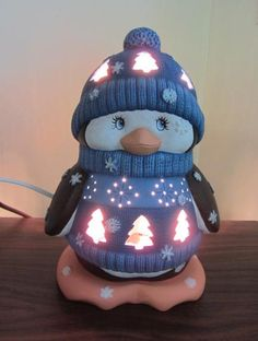 Ceramic lighted Penguin.    This penguin is sooo cute!! He will light up your winter, he has a two toned blue colored sweater and hat on that has