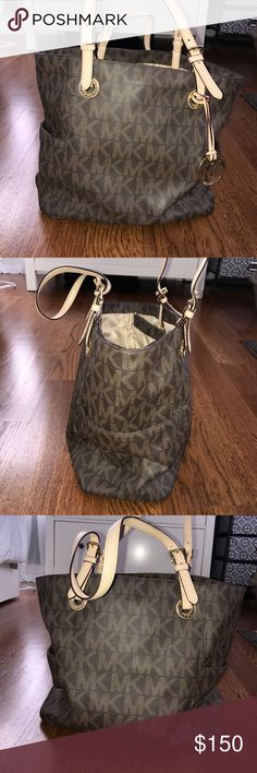 Michael Kors Bag Used, but in great condition. No marks or frailing. Great storage with side pockets on each side of the bag, middle zipper compartment, front inside of the bag includes a small zipper, two pockets and an attached clip. Backside of inside of Bag includes two pockets. Michael Kors Bags Shoulder Bags