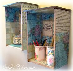 Cool altered Drawers become wall shelves! Vicki decoupaged 2 old drawers using papers that will be on CD #3 Creating With Vintage Typography. She also decorated some tins and jars to hold stuff and punched little daisies from the map paper. See details and more photos on her blog.
