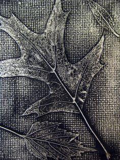Tutorial doing inexpensive Leaf Relief--cardboard, leaves, aluminum foil, black spray paint, and steel wool.