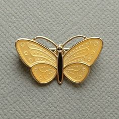 An Enchanting Aksel Holmsen Vintage Norwegian Butterfly Brooch Pin in Sterling Silver 925S Vermeil with Sunny Yellow and Black Enamel, Secure Safety Catch Closure, Signed and Hallmarked, circa 1950s!  Measurements are 7/8 across by 1/2 tall.  This Butterfly Brooch is hallmarked with the W Bench Tool Mark arranged back to back which stands for Aksel Holmsen accompanying NORWAY STERLING 925S. Aksel Holmsen was a major manufacturer of silver jewelry in Sandefjord, Norway. Their jewelr...