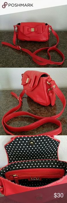 Small cute purse Coral bright orange small side purse, can use as cross body.. i might have used this once, in great condition!!! Lulu Bags Crossbody Bags