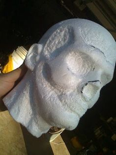 Carved zombie head from a styrofoam head .