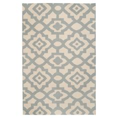 Bring a pop of style to your living room or master suite with this hand-woven wool rug, showcasing medallion motif in stormy sea.  P...