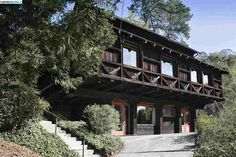 This intriguing Berkeley home is one of a trio of structures built as a small community on the edge of Glendale-La Loma Park in the early 20s. It is a fairly late example of the rough-hewn Swiss ch...