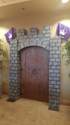 Castle backdrop for pictures columns were wrapped with cardboard painted to be stones.  Door made of cardboard with real hinges