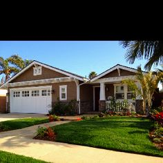 A flat roofed beach bungalow remodeled to craftsman style.  We love our little house.