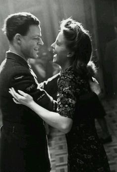 This day in history, April 22nd,1944, an airman shared a joke with his girlfriend as they danced. It's a jovial moment of romantic bliss, despite the ongoing international war. Couples like this would marry and create the post-war baby boom culture during the Cold War era. Their years of rationing transitioned to a consumer culture to build nuclear families in the suburbs. Original Publication: Wartime Dance Hall, 1944 (Photo by Leonard McCombe) #1944 #WWII #airman #dance #coldwar…