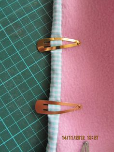 use hair clips to hold binding in place!