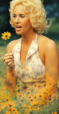 Tammy Wynette, so beautiful, and boy could she sing stories about real life. Miss you Tammy!