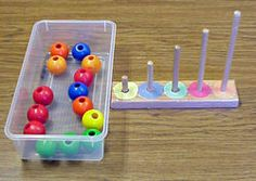 Bead stacking TEACCH task for children with autism and in ABA therapy. Fine motor and color identification.