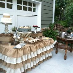 This ruffle table cloth for craft fairs/farmers market in an old curtains or sheeting plus burlap.