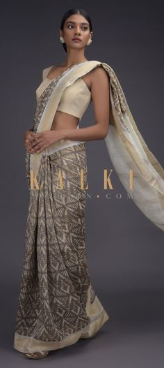 Rhino grey saree in tussar silk with batik print in geometric jaal pattern. It comes with a white border and pallu with zari weaved design. Grey Saree, Plain Saree, Batik Prints, Indian Attire, Printed Sarees, Designer Sarees, Silk Sarees, Ethnic, Sari