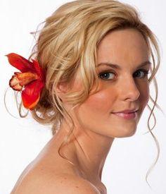 beach wedding hairstyles, beach wedding updo, tropical flower in hair
