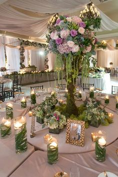 """Nature's Secret Garden"" towering moss centerpiece. This would be amazing for an enchanted forest themed wedding!"
