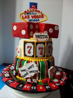 Vegas cake Red velvet and strawberry cake with cream cheese and whipped topping fillings. This cake gave me the opportunity to use my fondant tools. I used the JEM card maker set for lower signs and free hand the Vegas sign. Letter cutters were used for the letters and numbers. everything is is gumpaste including the chips and dice. Food markers were used to accent pieces. Thank you for looking