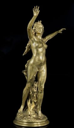 'Spring', circa 1900 Large gilded bronze sculpture of a nude woman, her hair cascading set allegory of spring, round base.