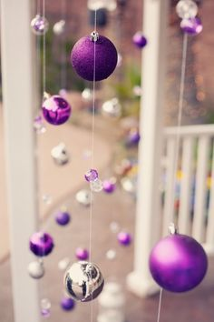 I love this idea for my porch. String icicle Christmas lights back and forth along the ceiling of the porch so it looks like rain...then the orniments hanging underneath.