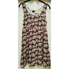 "Floral Babydoll Dress Sleeveless. Pink floral print. Bust is sheer, skirt is lined. Hidden side zipper. 33"" L. Good condition. Shell and lining 100% polyester. Forever 21 Dresses Mini"