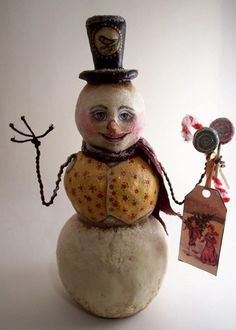 Snowman with wire arms   http://folkartbypenny.blogspot.com/