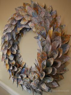 Map Wreath - made from atlas pages - large 22 inch newspaper rosette and leaf. $65.00, via Etsy.