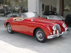 I've never been a car person. I just need something to get me from point A to point B with the least amount of hassle. But this, this right here, this is my dream car. Jaguar XK150 (1957-1961)