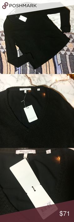 NWT Bella Luxx Black V neck sweater NWT Bella Luxx Los Angeles Black V neck sweater • Fine knit sweater front and sleeves • Contrast material for the back of the sweater • Features ribbed cuffs • Perfect basic sweater to layer under or wear solo  Tag: • Size Small • Body: 100% Nylon • Contrast: 100% Viscose • Dry Clean Only   Measurements (flat): • 18 inches (pit to pit) • 26 inches (top of neckline to bottom of hem) Bella Luxx Sweaters V-Necks