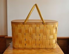 This is a wonderful vintage golden yellow woven wood splint picnic basket made by the Burlington Basket Company in Burlington, Iowa in the