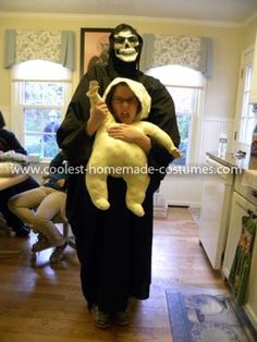 Homemade Monster Abduction Costume: This is my daughter dressed as a monster carrying a baby. I used a box as the costume frame. I cut holes in the box for her arms and head. On the back