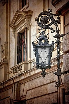 A elegantly ornate, wrought iron steetlamp in the historic centre of Valencia, Spain. Old Style Street Lamp in Valencia Spain has a little added texture to complete the vintage feel. Architecture Old, Architecture Details, Muebles Estilo Art Nouveau, Spot Lumiere, Old Lamps, Lantern Lamp, Valencia Spain, Street Lamp, Outdoor Walls