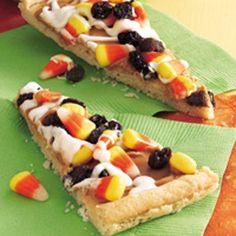 Halloween Cookie Pizza Sugar cookie, peanut butter, candy corn, raisins and vanilla frosting