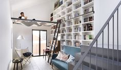 Designed by Egue Y Seta, this inspiring apartment is located in Madrid, Spain. The designers turned an old Madrid house from the into a new and welcoming home to a young couple with kids. They reconstructed the unique place, with pieces of custo Home Library Design, House Design, Library Ideas, Library Ladder, Bookshelf Ladder, Mini Library, Library Chair, Small Home Libraries, Madrid Apartment