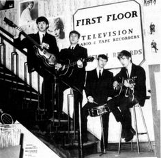 "January 24,1963 - The Beatles made a personal appearance at manager, Brian Epstein's store, NEMS in Liverpool prior to a performance in Wales. They signed copies of the newly released ""Please Please Me"" 45 RPM single, and did a brief acoustic concert at the foot of the stairs."