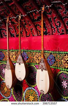 Dombra string instruments on the wall of Kazakh yurt at Nauryz celebration in Almaty, Kazakhstan - stock photo
