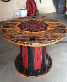 Wooden Spool FireFighter table *Similar* Firefighter Home Decor, Firefighter Gear, Volunteer Firefighter, Firefighters, Firefighter Wedding, Fire Hose Projects, Wood Projects, Fire Hose Crafts, Spool Tables