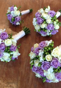 Mauve Roses Wedding Bouquet from The Wild Orchid Florist, Echuca Victoria. 0354806777 #mauveroses #echucaflorist #greenberries #thewildorchid