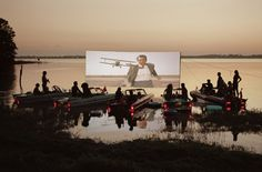Tim Walker. Floating Drive-In. grab a screen, projector, and a canoe and off to the lake.