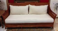"""Casual, rattan sofa with the look that says """"easy, island living."""" Rattan and split cane frame with natural cotton cushions. 75"""" x 30"""" x 34.5"""" tall back."""