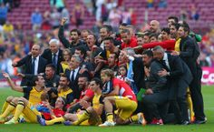 The players and coaching staff of Club Atletico de Madrid celebrate winning the La Liga after the match between FC Barcelona and Club Atletico de Madrid at Camp Nou on May 17, 2014 in Barcelona, Catalonia.