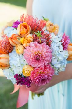 A bright and happy wedding bouquet with pinks, oranges, yellows and soft blues!