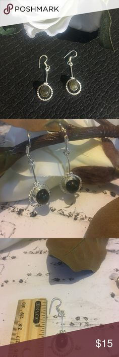 ⚜️Labradorite Earrings⚜️ Labradorite earrings with suspended stone⚜️Labradorite stone used for expansion, sensory awareness and protection against negativity.⚜️925 overlay without stamped⚜️Hook fastening⚜️Earring L without hook approximately 1 inch⚜️Colors may vary and measurements are approximate Jewelry Earrings
