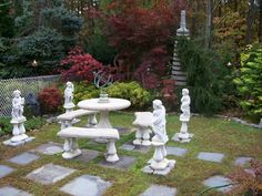 Table Set with Four Season Statues