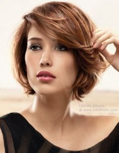Short layered bob with the ends curved inwards.