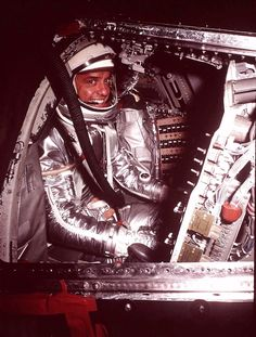 Astronaut Alan Shepard, Jr., poses in the Mercury space craft at Cape Canaveral in 1961. Shepard, the first American to fly in space and one of only 12 Americans to walk on the moon.