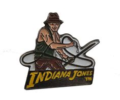 """INDIANA JONES vintage enamel pin button movie promo official Raiders of the Lost Ark by VintageTrafficUSA  35.00 USD  20 years old very hard to find promo pin! A vintage Indiana Jones Pin! 1983 LFL on the back I think... Excellent condition. Measures: approx 2"""" -------------------------------------------- SECOND ITEM SHIPS FREE IN USA!!! LOW SHIPPING OUTSIDE USA!! VISIT MY STORE FOR MORE ITEMS!!! http://ift.tt/1PTGYrG FOLLOW ME ON FACEBOOK FOR SALE CODES AND UPDATES! http://ift.tt/1P57awb OR…"""
