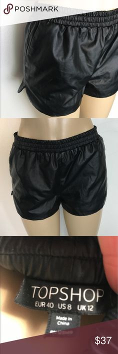 NWOT Women's faux leather shorts by Topshop NWOT Women's faux leather shorts by Topshop, never worn, elastic band with side pockets. Ships immediately size 8 Topshop Shorts