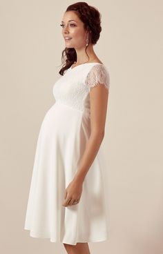 Leavers lace brings a magical quality to all of our maternity wedding gowns but Eleanor is truly magnificent. A smart knee-length version of our Leavers lace full-length gown awash with all the same beautiful details.