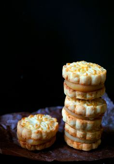 http://www.misshangrypants.com/2015/09/lotus-seed-and-salted-egg-yolk-cookie.html  Lotus seed paste and salted egg yolk cookie sandwich. A play on mooncakes for mid-autumn festival.