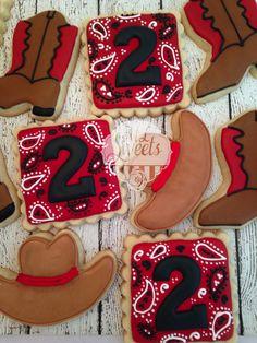 Cowboy sugar cookies, with cowboy boots, cowboy hats and paisley cookies.